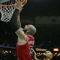 February 12, 2011; New Orleans, LA, USA; Chicago Bulls power forward Carlos Boozer (5) shoots over New Orleans Hornets power forward David West (30) during the third quarter at the New Orleans Arena.  The Bulls defeated the Hornets 97-88. Mandatory Credit: Derick E. Hingle