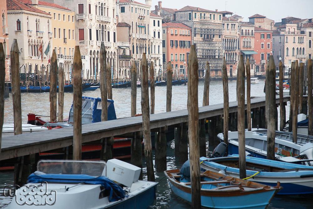 Italy Venice jetty with boats