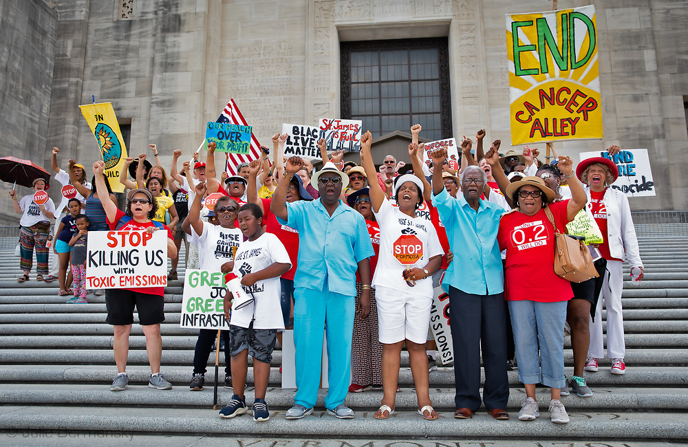Lavigne with members of the Coalition Against Death Alley (CADA) on the steps of the State Capitol on June 3, 2019, at the end of a five day protest event. The group called for tighter regulation of existing plants and end of the building of new ones.