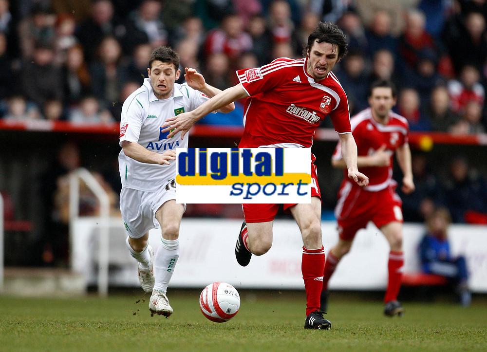 Photo: Richard Lane/Richard Lane Photography. Swindon Town v Norwich City. Coca-Cola Football League One. 20/03/2010. Norwich's Wes Hoolahan challenges Swindon's Jonathan Douglas (rt).