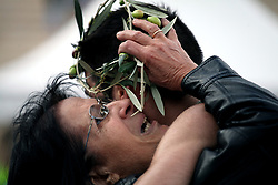November 12, 2017 - Athens, Attica, Greece - A mother hugs her son at the finish line at the Panathenaic stadium offering him an olive wreath at the 35th Athens Classic Marathon in Athens, Greece, November 12, 2017. (Credit Image: © Giorgos Georgiou/NurPhoto via ZUMA Press)