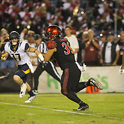 10 September 2016: The San Diego State Aztecs football team hosts Cal in their second game of the season. San Diego State linebacker Ronley Lakalaka (39) intercepts a pass and runs in back for a touchdown in the second quarter. The Aztecs lead 31-21 at halftime.