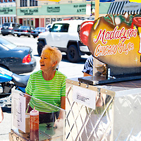 "Photo of Madalyn the Hot Dog Lady of Crown Point Indiana in 2010. Sadly, Madalyn hasn't been in the square for the summer of 2011 and has apparently retired. She was a part of life in Crown Point for a long time and will be missed. Crown Point is located in Northwest Indiana with a population of over 37,000. Crown Point and Lake County are about 50 miles from Chicago and are considered part of the ""Chicagoland"" area. Crown Point has a traditional small town America feel with a main street consisting of the old Lake County Courthouse surrounded by numerous small businesses, known as ""the square"", including a theater, ice cream shop, antique stores, and restaurants."