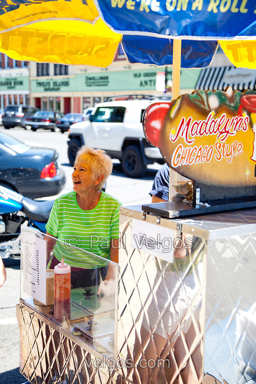 """Photo of Madalyn the Hot Dog Lady of Crown Point Indiana in 2010. Sadly, Madalyn hasn't been in the square for the summer of 2011 and has apparently retired. She was a part of life in Crown Point for a long time and will be missed. Crown Point is located in Northwest Indiana with a population of over 37,000. Crown Point and Lake County are about 50 miles from Chicago and are considered part of the """"Chicagoland"""" area. Crown Point has a traditional small town America feel with a main street consisting of the old Lake County Courthouse surrounded by numerous small businesses, known as """"the square"""", including a theater, ice cream shop, antique stores, and restaurants."""
