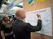 © Licensed to London News Pictures. 29/09/2014. Birmingham, UK. William Hague leaves a message of support on the Friends of the Ukraine trade stand.  The Conservative Party Conference in Birmingham 29th September 2014. Photo credit : Stephen Simpson/LNP