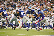 IRVING, TX - OCTOBER 23:  Quarterback Eli Manning #10 of the New York Giants hands the ball off to running back Tiki Barber #21 on a running play against the Dallas Cowboys at Texas Stadium on October 23, 2006 in Irving, Texas. The Giants defeated the Cowboys 36-22. ©Paul Anthony Spinelli *** Local Caption *** Eli Manning;Tiki Barber