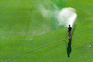 A member of the grounds crew at Target Field waters the outfield before a game between the Baltimore Orioles and Minnesota Twins in Minneapolis, Minnesota on July 16, 2012.  The Twins defeated the Orioles 19 to 7 setting a Target Field record for runs scored by the Twins.  © 2012 Ben Krause