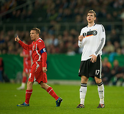 MONCHENGLADBACH, GERMANY - Wednesday, October 15, 2008: Wales' captain Craig Bellamy and Germany's Per Mertesacker during the 2010 FIFA World Cup South Africa Qualifying Group 4 match at the Borussia-Park Stadium. (Photo by David Rawcliffe/Propaganda)