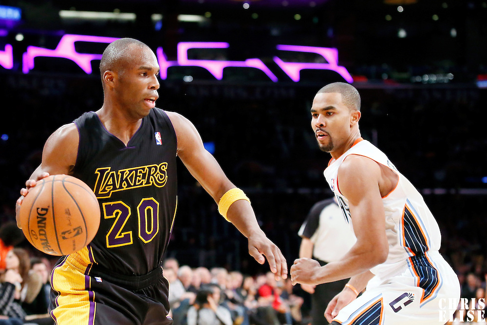 31 January 2014: Los Angeles Lakers shooting guard Jodie Meeks (20) drives past Charlotte Bobcats point guard Ramon Sessions (7) during the Charlotte Bobcats 110-100 victory over the Los Angeles Lakers at the Staples Center, Los Angeles, California, USA.