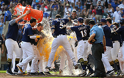 September 23, 2017 - Milwaukee, WI, USA - Milwaukee Brewers batter Travis Shaw is greeted by teammates after hitting a game-winning, two-run home run in the 10th inning against the Chicago Cubs on Saturday, Sept. 23, 2017 at Miller Park in Milwaukee, Wis. (Credit Image: © Chris Sweda/TNS via ZUMA Wire)