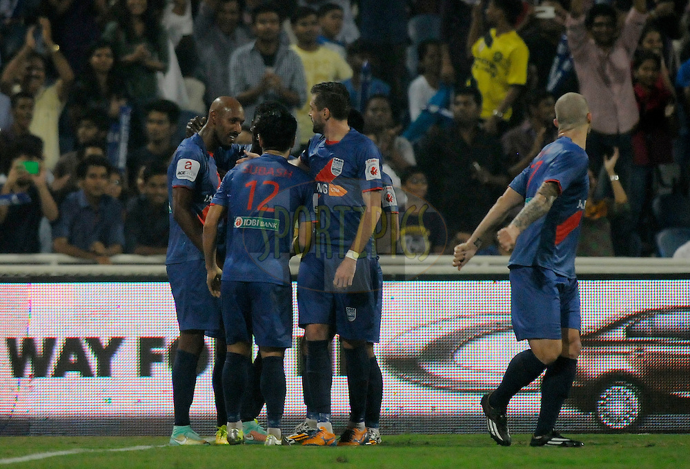 Nicolas Anelka of Mumbai City FC is congratulated by teammates after scoring a goal during match 22 of the Hero Indian Super League between Mumbai City FC and Delhi Dynamos FC City held at the D.Y. Patil Stadium, Navi Mumbai, India on the 5th November.<br /> <br /> Photo by:  Pal Pillai/ ISL/ SPORTZPICS
