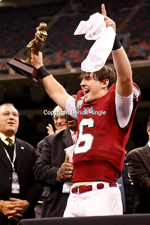 December 18, 2010; New Orleans, LA, USA; Troy Trojans quarterback Corey Robinson (6) holds up the MVP trophy following a win over the Ohio Bobcats in the 2010 New Orleans Bowl at the Louisiana Superdome. Troy defeated Ohio 48-21. Mandatory Credit: Derick E. Hingle