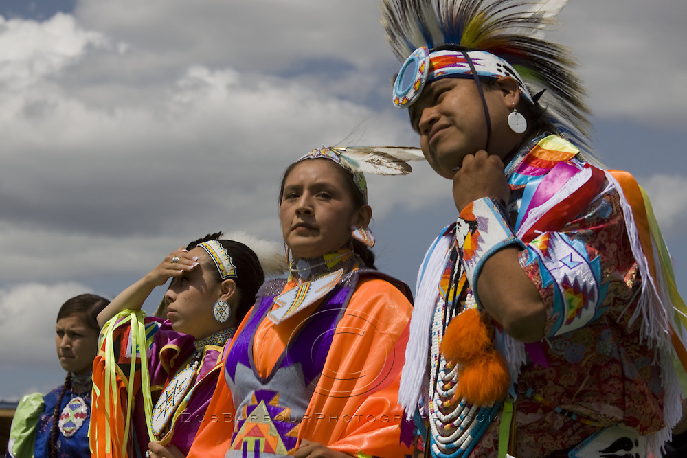 Native American males and females chatting at ceremonial Pow Wow at Browning , Montana