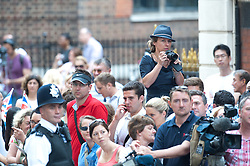 Members of the public are seen waiting outside St. Mary's hospital trying to get a glimpse as The Duke and Duchess of Cambridge and their newborn son are staying following the birth of the Royal baby,<br /> London, United Kingdom<br /> Tuesday, 23rd July 2013<br /> Picture by Piero Cruciatti / i-Images