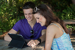 North America, United States, Washington, Kirkland, young couple with tablet pc in park.  MR