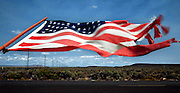 Wind whips a flag along a fenceline south of Burns, Oregon in Harney County, one of the largest and least populated counties in America some have called &quot;The Big Empty.&quot;<br /> Alan Berner / The Seattle Times