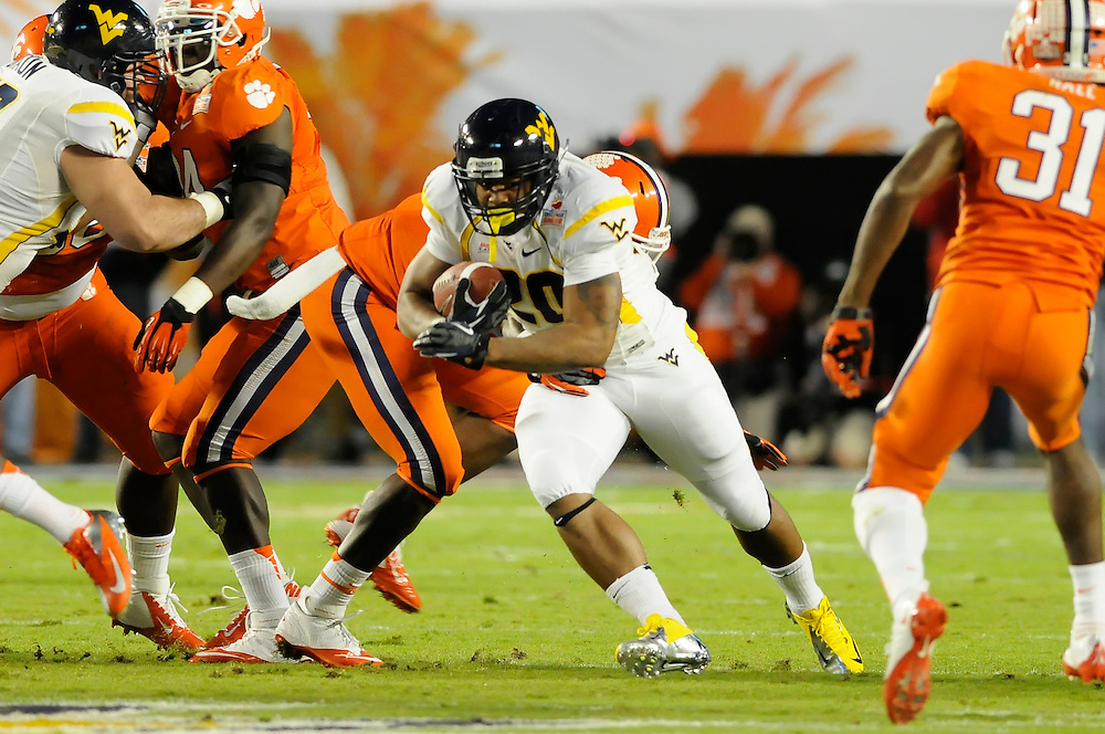 January 4, 2012: Shawne Alston #20 of West Virginia in action during the NCAA football game between the West Virginia Mountaineers and the Clemson Tigers at the 2012 Discover Orange Bowl at Sun Life Stadium in Miami Gardens, Florida.