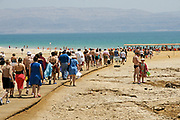 Tourist at the Ein Gedi Beach of the Dead Sea, Israel