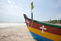 Fishing boat with crucifix sign at Anjuna Beach, Goa, India