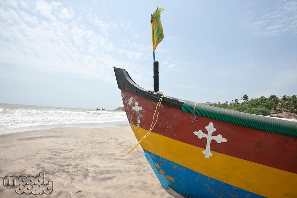 Fishing boat with crucifix sign at Anjuna Beach, Goa, India