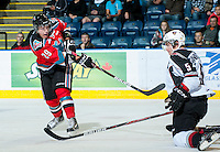 KELOWNA, CANADA - OCTOBER 3: Myles Bell #29 of the Kelowna Rockets takes a shot against the Vancouver Giants at the Kelowna Rockets on October 3, 2012 at Prospera Place in Kelowna, British Columbia, Canada (Photo by Marissa Baecker/Getty Images) *** Local Caption *** Myles Bell;