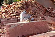 Stonemason using traditional manual skills at stone workshop at Humayuns Tomb,  in New Delhi, India