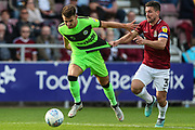 Forest Green Rovers Liam Shephard(2) runs forward and has his shirt pulled by Northampton Towns David Buchanan(3) during the EFL Sky Bet League 2 match between Northampton Town and Forest Green Rovers at Sixfields Stadium, Northampton, England on 13 October 2018.