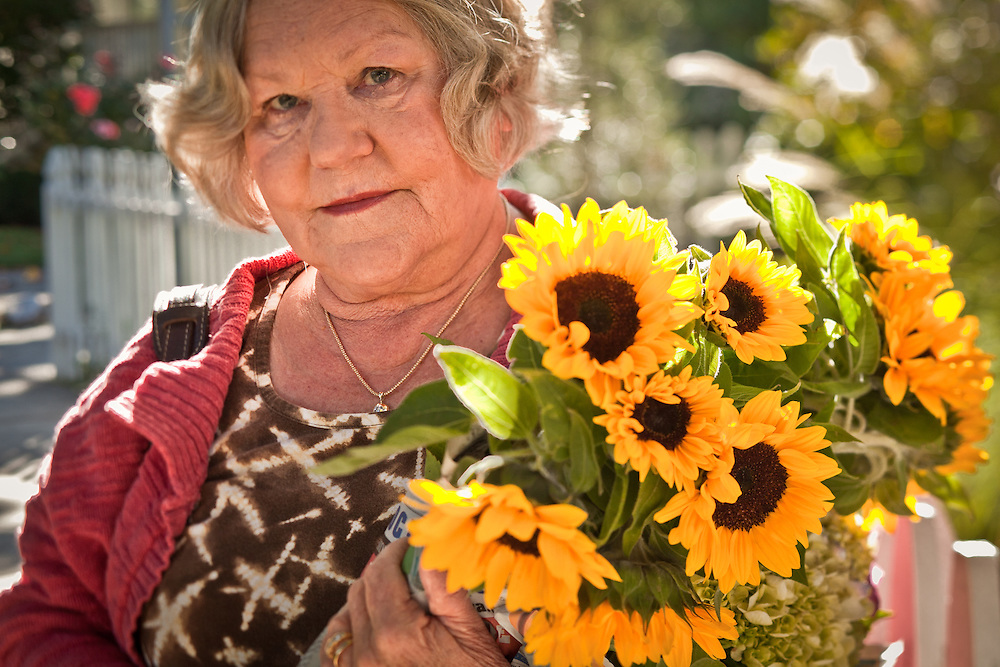 Lilia Gallion with sun flowers from Saturday Market, Calistoga, CA
