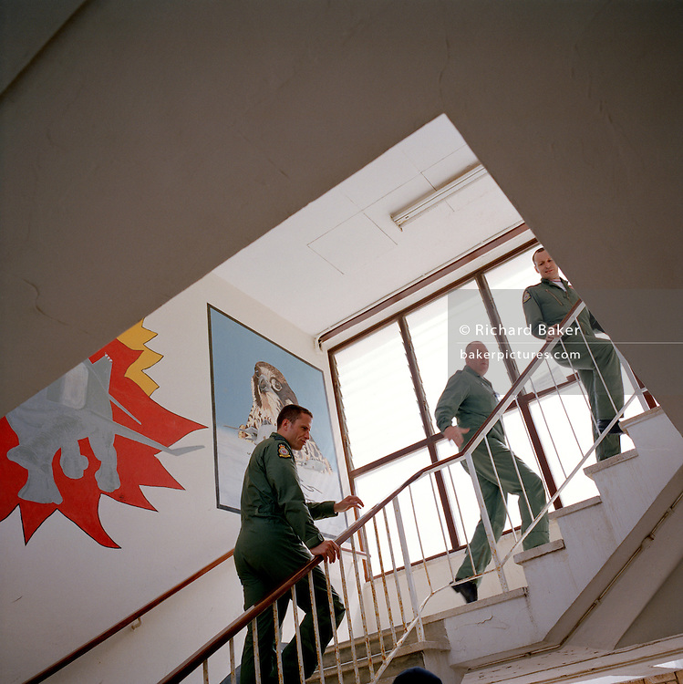 Pilots of the Red Arrows, Britain's RAF aerobatic team climb the steps in the Squadron Building's crew room at RAF Akrotiri.