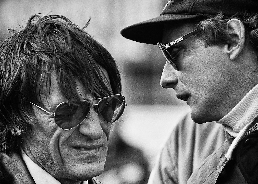 Two-time World Champion Niki Lauda delivers news of a possibly fatal oil leak in his Brabham Alfa Romeo to team owner Bernie Ecclestone before the start of the 1978 United States Grand Prix at Watkins Glen.  <br /> <br /> It proved to be a result of a porous engine casting. The engine failed on the 28th lap. <br /> <br /> Lauda's move from Ferrari to Brabham-Alfa Romeo in 1978 proved to be a disaster, with the car failing to finish in seven of eleven Grands Prix. <br /> <br /> His only success was his victory in Sweden driving the notorious BT46C &quot;fan car&quot;, which Brabham promptly shelved to avoid probable banning. <br /> <br /> Lauda tolerated one more season with 11 out of 13 Alfa Romeo failures and then retired...for the first time. He would return in 1982 with McLaren and win his third World Championship in 1984.