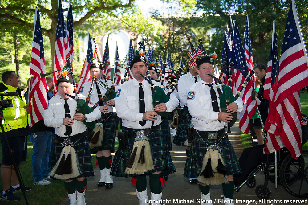 1 Oct 2017 Elmont, New York United States of America // FDNY emerald society pipes and drums practice march down a flag lined path to the ceremony to kickoff the 3RD annual national stair climb for fallen firefighters at the Belmont Park racetrack  Michael Glenn  /   for the FDNY