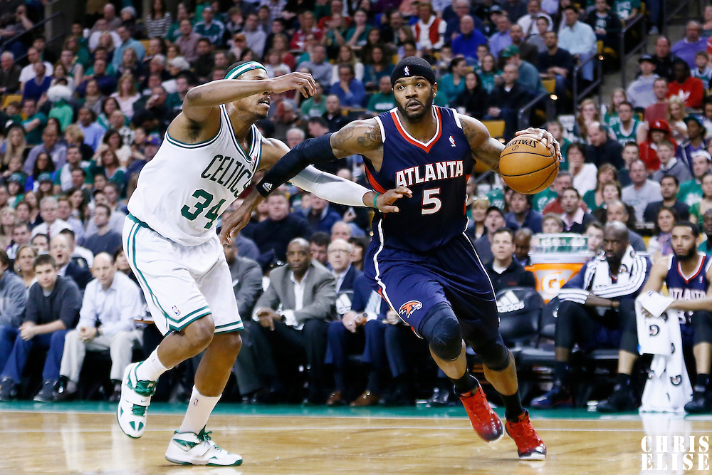 29 March 2013: Atlanta Hawks small forward Josh Smith (5) drives past Boston Celtics small forward Paul Pierce (34) during the Boston Celtics 118-107 victory over the Atlanta Hawks at the TD Garden, Boston, Massachusetts, USA.