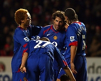 Photo: Chris Ratcliffe.<br />Charlton Athletic v Manchester United. The Barclays Premiership. 19/11/2005.<br />Ruud Van Nistlerooy (C) is congratulated by Man Utd players after winning the game for them