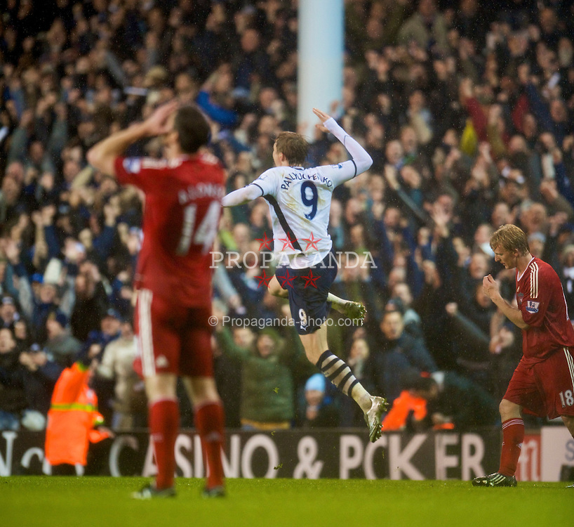 LONDON, ENGLAND - Saturday, November 1, 2008: Tottenham Hotspur's match-winner Roman Pavlyuchenko celebrates as Liverpool's Xabi Alonso looks dejected after his side's unlikely 2-1 victory during the Premiership match at White Hart Lane. (Photo by David Rawcliffe/Propaganda)