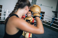 Chiang Mai, Thailand -- May 20, 2017: Thays Runge, a German traveler, sparring with her trainer at the Chiangmai Muay Thai Training Center in northern Thailand.