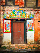 01 AUGUST 2015 - KATHMANDU, NEPAL:  An ornate doorway to a brick building in Kathmandu, Nepal.      PHOTO BY JACK KURTZ