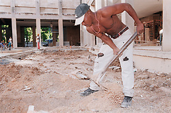 Construction worker in Havana working on the renovation of the Fine Art Museum  Museo de Bellas Artes,