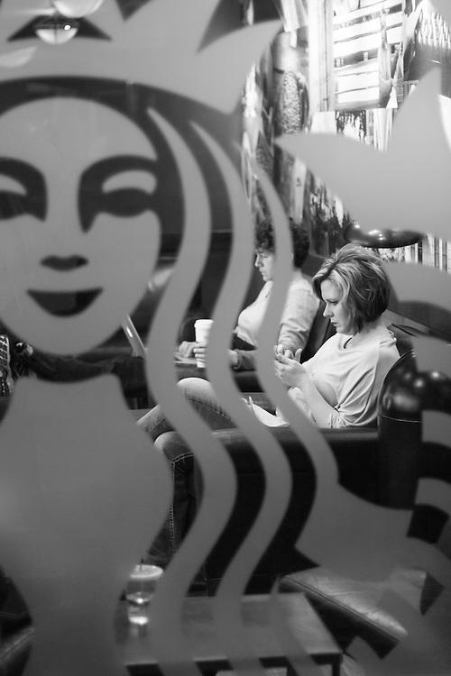 Women in Starbucks coffee shop.
