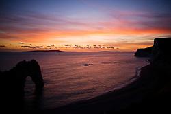 Durdle Door at sunset, Jurassic Coast, Dorset, England, UK.