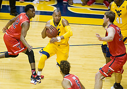 Mar 2, 2016; Morgantown, WV, USA; West Virginia Mountaineers guard Jevon Carter (2) drives between Texas Tech Red Raiders defenders during the first half at the WVU Coliseum. Mandatory Credit: Ben Queen-USA TODAY Sports