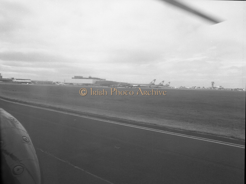 Aerial Views of Shannon Airport.     (N88)..1981..11.08.1981..08.11.1981..11th August 1981..Shannon Airport is situated in Co Clare in the west of Ireland. It is the best located airport in Ireland for tourism on the western seaboard, Kerry, Galway, The Burren etc...Series of aerial images of Shannon Airport and out into the Shannon Estuary taken from aboard an aircraft