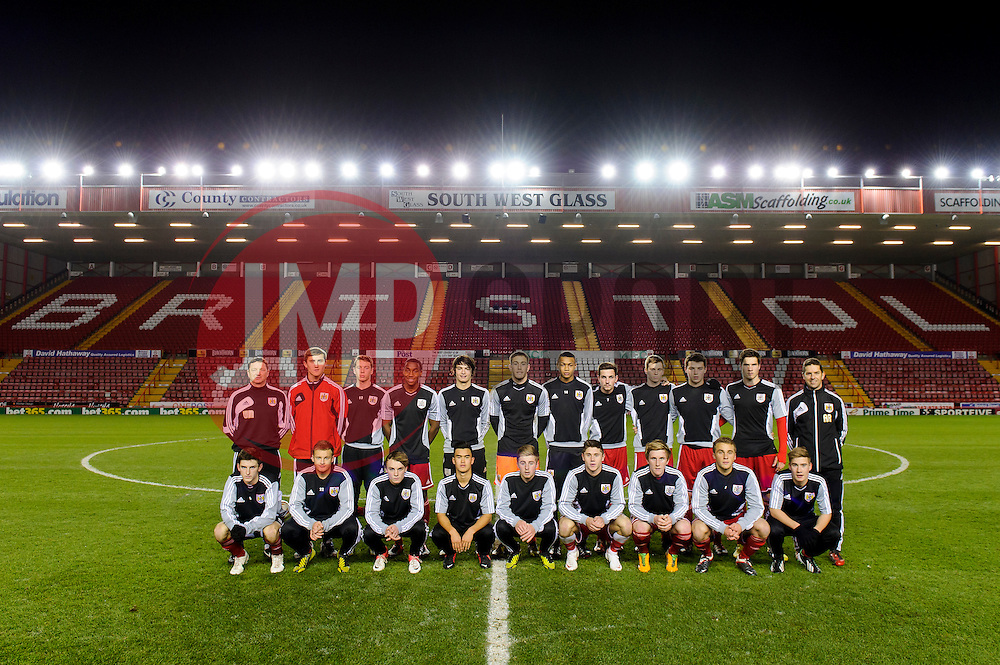 Bristol City U18 players pose for a team photo on the pitch before their FA Youth Cup Third Round Proper match against Ipswich Town U18s.Back Row L-R: Head of Academy Coaching Willie McStay, ?, Tyson Pollard, Jamal Simms, Max O'Leary, Dylan Castanheira, Marley Bishop, Lewis Hall, Harry Paice, Chris Abbott, Pierce Mitchell, U18s Manager Alex RussellFront Row L-R:? , Rhys Jordan, Tyson Pollard, Miles John, Joe Morrell, Wes Burns, Conor Lemonheigh Evans, Will Cline, ?Photo mandatory by-line: Rogan Thomson/JMP - Tel: Mobile: 07966 386802 - 04/12/2012 - SPORT - FOOTBALL - Ashton Gate Stadium - Bristol. Bristol City U18 Mid-Season Team Photo.