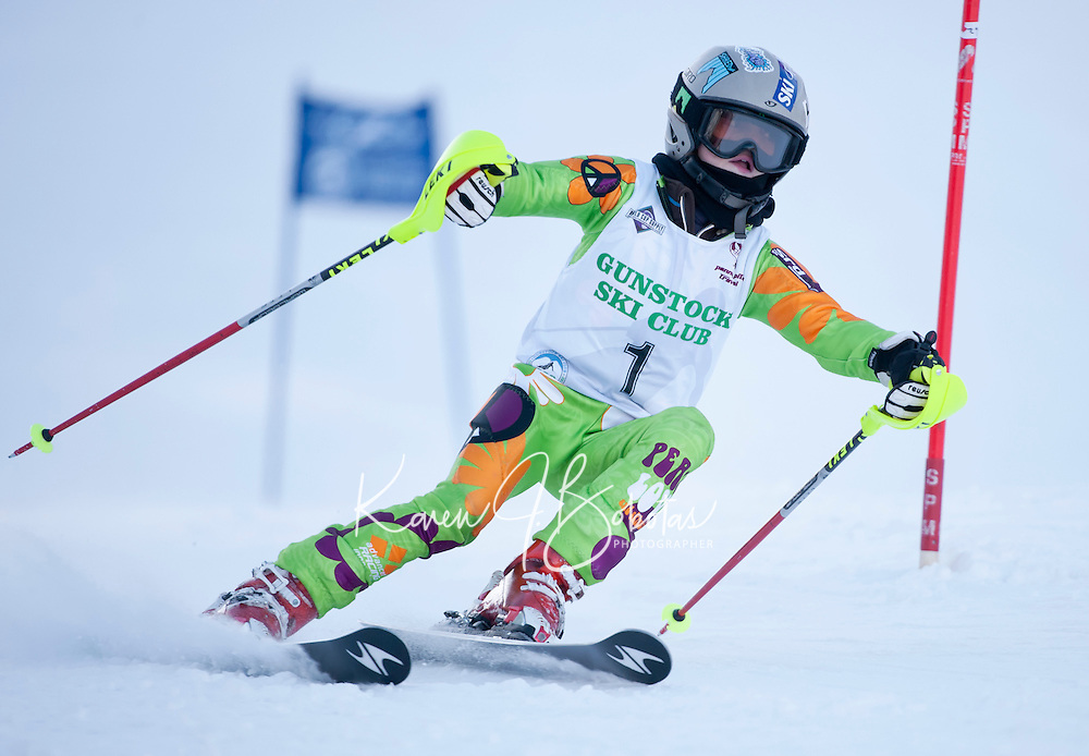 Zoe Zimmermann brings peace and love through the giant slalom course during the annual Gus Pitou alpine race at Gunstock Mountain Resort Thursday.  (Karen Bobotas/for the Laconia Daily Sun)