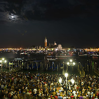 VENICE, ITALY - JULY 16: All sorts of boats  gather in St Mark; basin to watch the firework display on July 16, 2011 in Venice, Italy. Redentore is one of the most loved celebrations by Venetians which is a remembrance of the end of the 1577 plague. Highlights of the celebration include the pontoon bridge extending across the Giudecca Canal, gatherings on boats in the St Mark's basin and spectacular fireworks on display.
