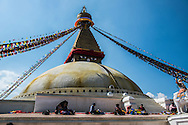 Workers prepare new prayer flags whilst sitting on the Boudhanath stupa in Kathmandu, Nepal.