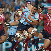 Wycliff Palu is tackled by Berrick Barnes during the Super14 match between the New South Wales Waratahs and Queensland Reds at the Sydney Football Stadium, Sydney, Australia on March 6, 2009. The Waratah's won the match 15-11. Photo by Tim Clayton.