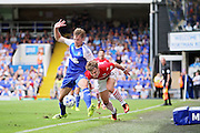 Barnsley forward Tom Bradshaw grapes with Ipswich Town defender Adam Webster during the EFL Sky Bet Championship match between Ipswich Town and Barnsley at Portman Road, Ipswich, England on 6 August 2016. Photo by Nigel Cole.