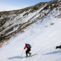 """Telemark skiing (with dog) """"The Seven"""" in the Great Gully on the headwall of King Ravine in New Hampshire's White Mountains.  King Ravine is a glacial cirque on the north side of Mount Adams.  Backcountry spring skiing."""