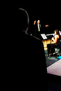 Denis DiBlasio, Director of Jazz Studies, watches from the wings as Earl Phillips stands in and directs the Lab Band during Rowan University's 2010 autumn Lab Band & Jazz Band performance.