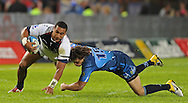 PRETORIA, South Africa, 14 May 2011. Cooper Vuna of the Melbourne Rebels is tackled by Zane Kirchner of the Bulls during the Super15 Rugby match between the Bulls and the Melbourne Rebels at Loftus Versfeld in Pretoria, South Africa on 14 May 2011..Photographer : Anton de Villiers / SPORTZPICS